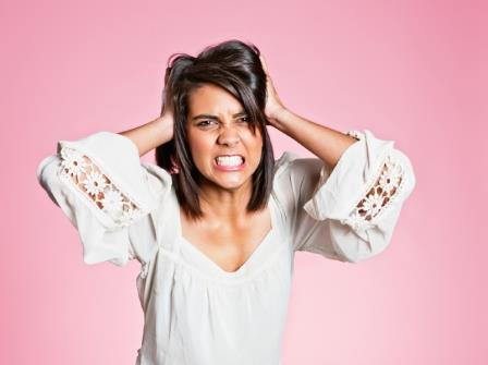agitated woman suffering from PMDD