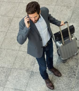 Modern casual business man on cell phone in hall airport. Top View