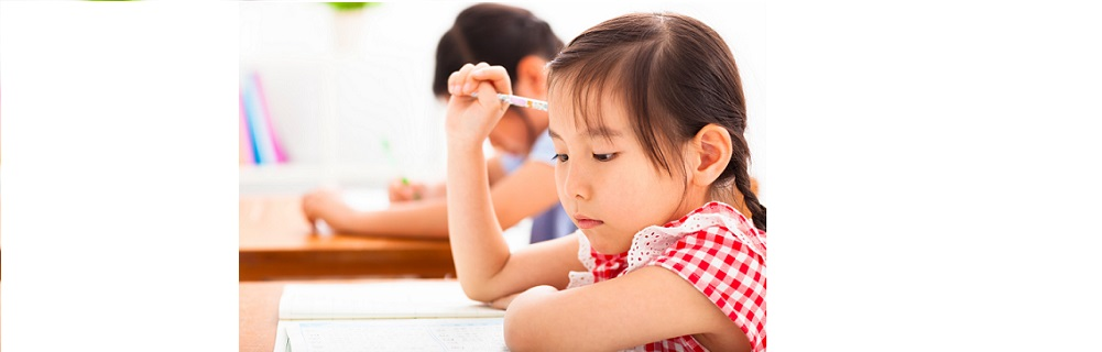 little girl thinking in the classroom