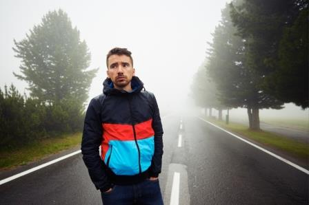 Sad man in fog on the road