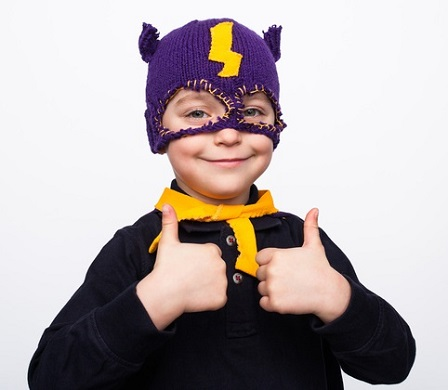 Charming boy in costume holding thumbs up