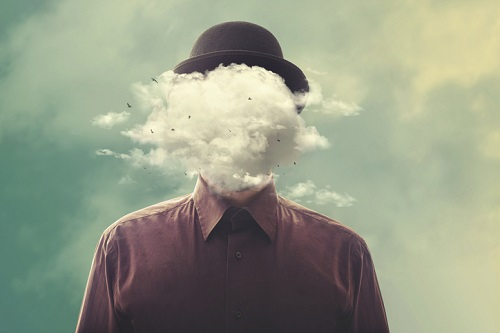 surreal man head in the cloud