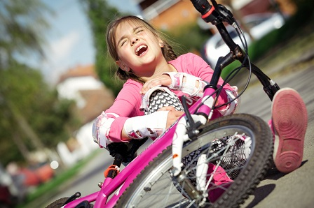 Little girl injured from bicycle crash