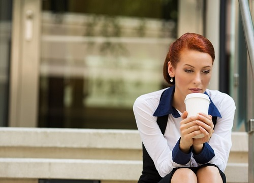 portrait stressed sad young woman sitting outdoors corporate office