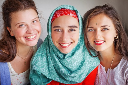 three young friends of different religions