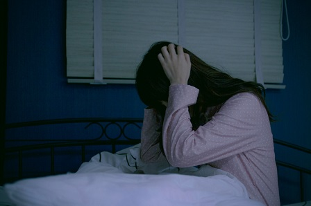 girl frightened of paranormal at night TO
