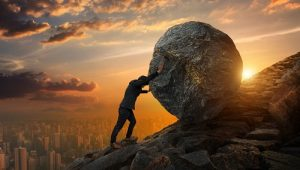 I am really struggling with life - man pushing boulder up hill