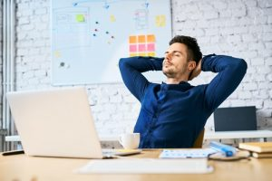 mindfulness and self-awareness man in meditation pose at work