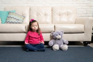 mindfulness matters cute little girl and teddy bear meditating